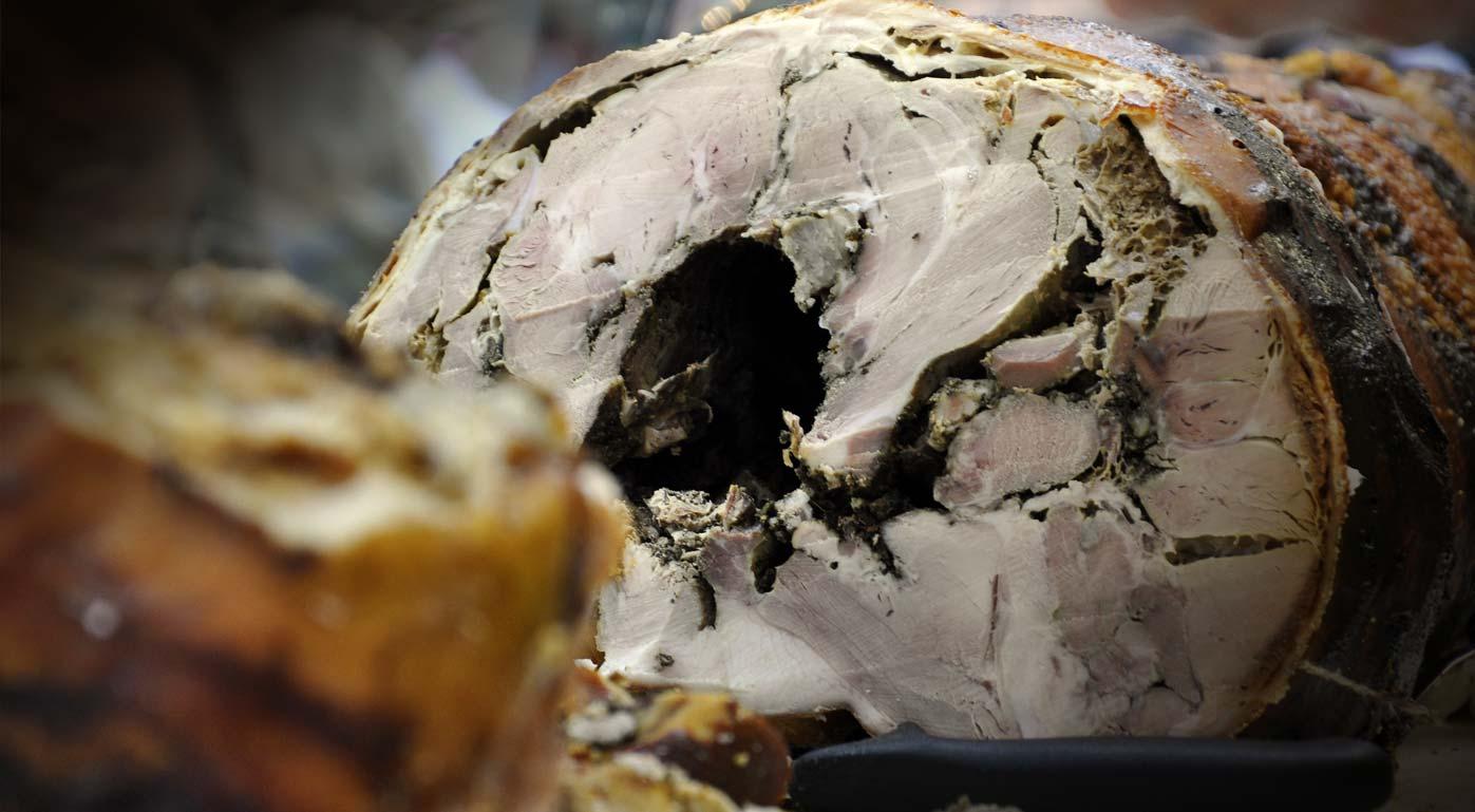 La Porchetta di Grutti: l'Antica Tradizione della Famiglia Benedetti